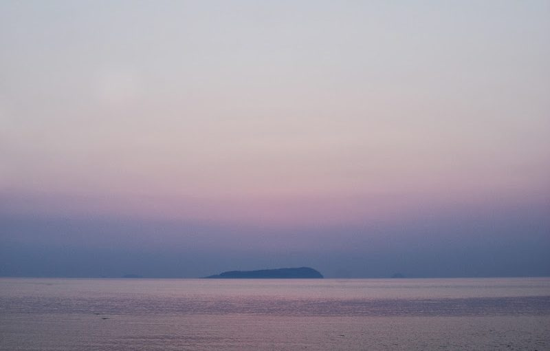 The sun disappeared behind Ibuki island at calm Seto Inland Sea.